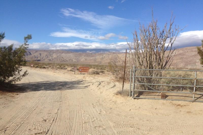 NO. 634 EL VADO - Continue driving through the gate onto the dirt road.