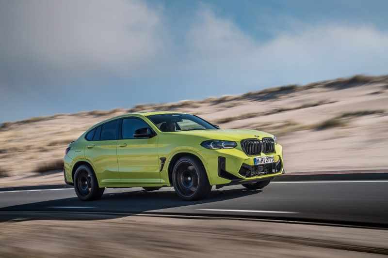 BMW X4 M side view driving
