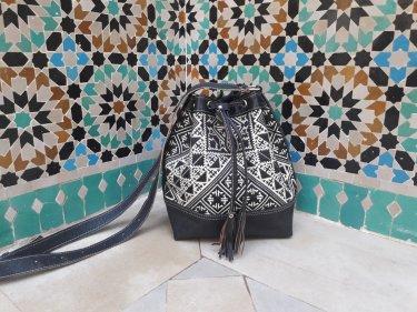 Black, White leather and Sabra silk bag