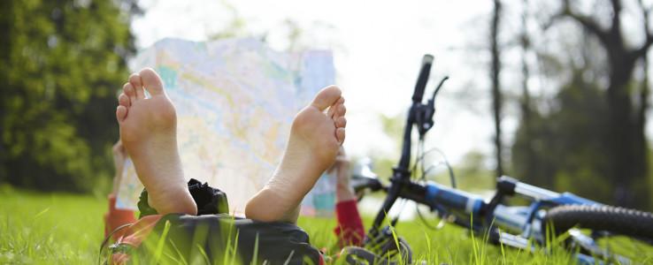 Hosteller reading a map in a field