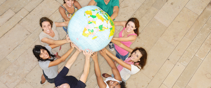 People holding an inflatable globe