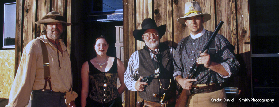 Members of the Cataract Creek Gang (John Moore, second from right) pose for a photo.