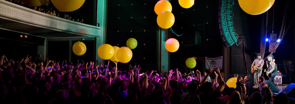 A 2014 performance at the Rialto in Tucson, Arizona, ends with large balloons.