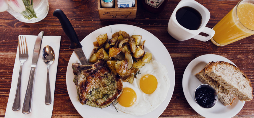 A typical meal of potatoes, eggs, coffee and a pork chop at Matt