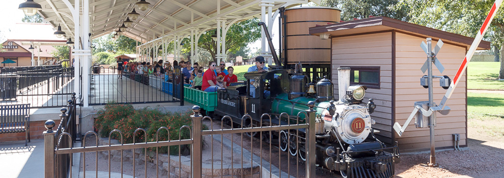 Riders aboard the McCormick Stillman Railroad miniature train wait for departure.