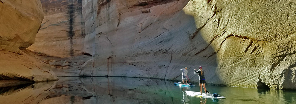 Two people paddleboarding on a section of the Colorado River