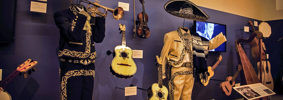 A display of Mariachi costumes and instruments at the MIM in Scottsdale, Arizona