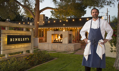 Kevin Binkley in front of his restaurant, Binkley
