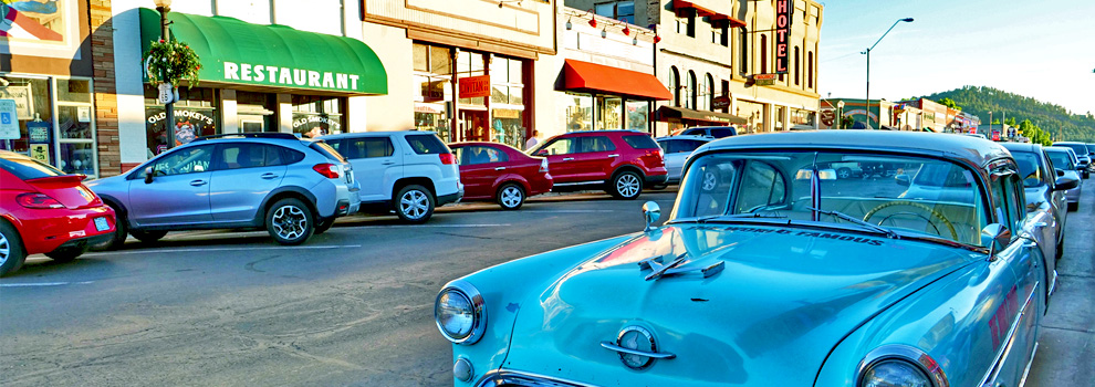 Cars parked along the sidewalk in downtown Williams, Arizona