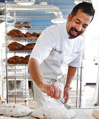 Don Guerra testing the dough for one of his famous bread loaves