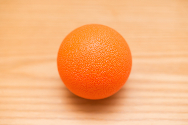 Orange massage ball for self-massage