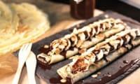 Crêpes sauce chocolat, bananes et amandes effilées