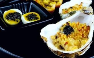 Huître chaude à la vodka et beurre de caviar