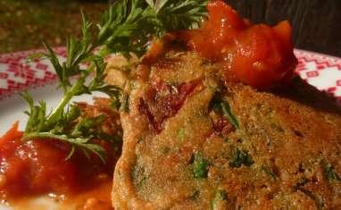 Beignets de fanes de carottes, tomates séchées et confit de tomates cerises