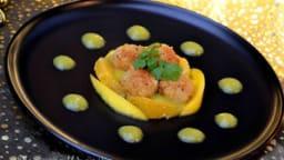Noix de Saint-Jacques panées au curry, coulis de mangue et orange au coriandre