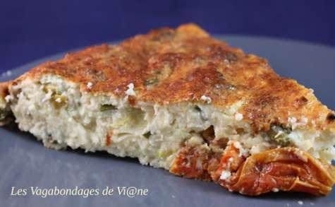 Gâteau de chou-fleur aux tomates confites et pistaches