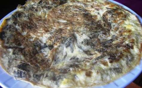 Omelette à la chicorée frisée et aux pignons de pin