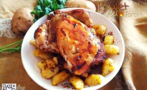 Poulet rôti farci accompagné de pommes de terre au four