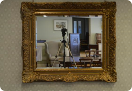 A large decorative gilt frame wall mirror