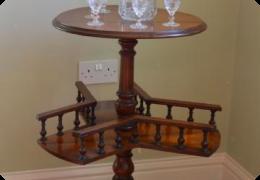 Walnut wine table with swivel base