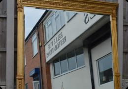 Large gilt frame Adams style wall mirror