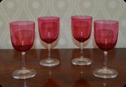 Four cranberry glass wine glasses