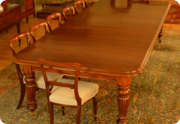 Large 19th Century mahogany pull out dining table, seats 12-14