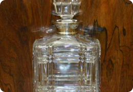 Cut glass whisky decanter, silver collar