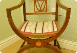 Edwardian mahogany X frame chair