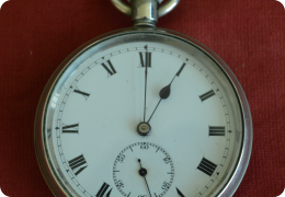 Nickel open face pocket watch with silver chain