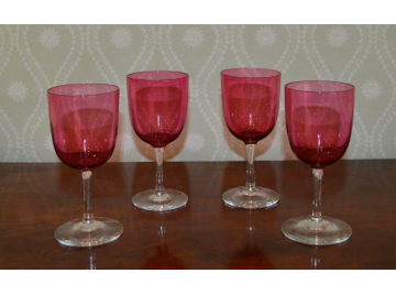 Four cranberry glass wine glasses