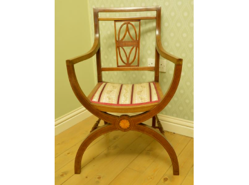 Edwardian mahogany X frame chair