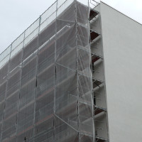 Effizienz und Sicherheit am Bau durch Gerüsteinhausung