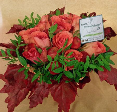 Flower arrangement with malus in small basket with autumn flavor