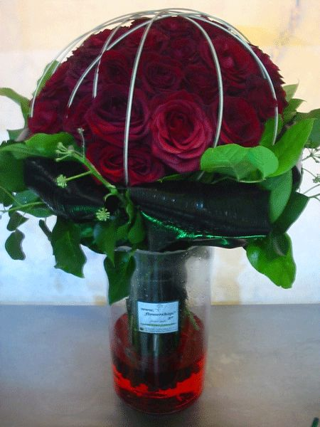 50 red roses bouquet A quality Dutch gift wrapped with greens  Vase