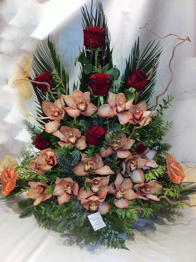 Arrangement with exclusive Red roses  Cymbidium ochids or Lillies