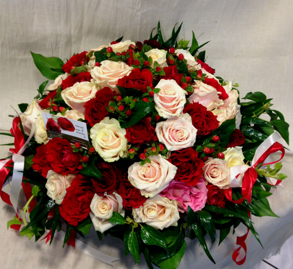 Pink And Red Roses 50 stems round basket arrangement Exclusive Varieties