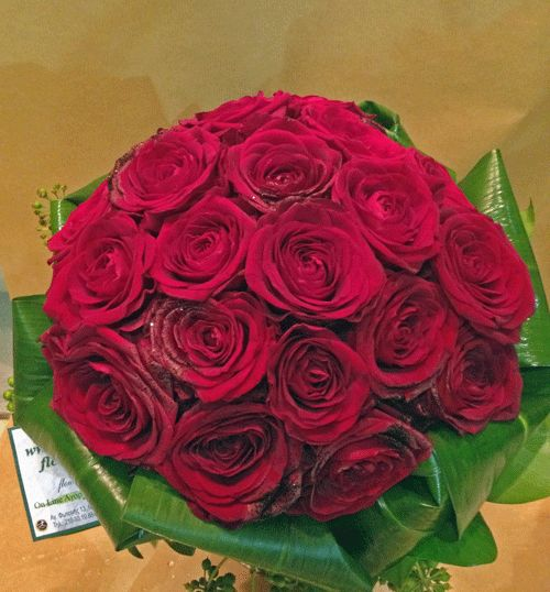 Wedding bouquet with red roses and greens