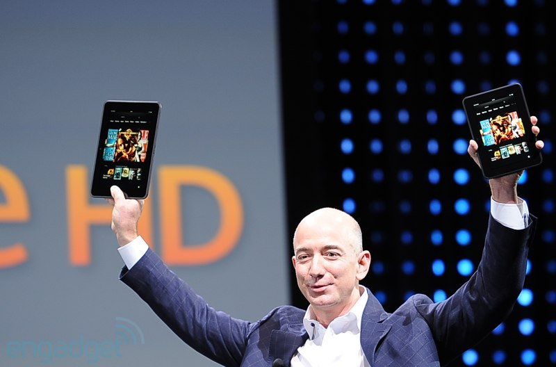 Jeff Bezos holding up the new Kindle Fire SD and HD
