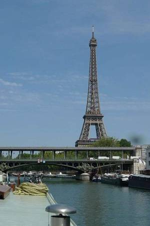 View on Eiffel tower from barge Johanna entering Paris on the Seine