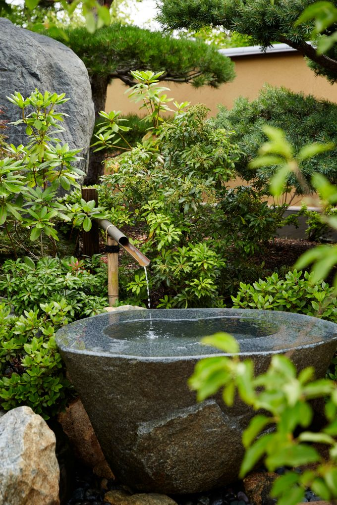 small stone fountain at Frederik Meijer Gardens