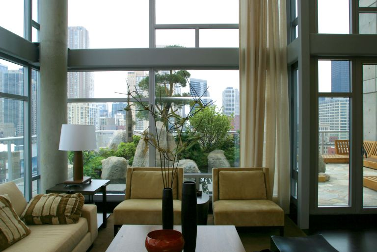 interior penthouse room with views of rooftop garden and Chicago