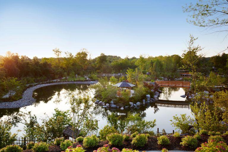 view of pond, path, gazebo, and bridge at Frederik Meijer Gardens