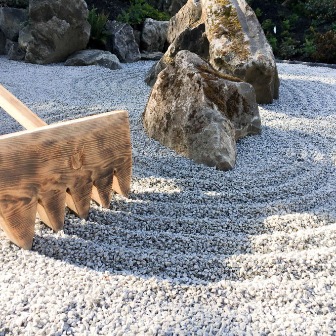 close up of raking rock garden