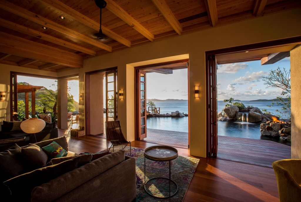 room with open door with view of water and sky at British Virgin Island residence
