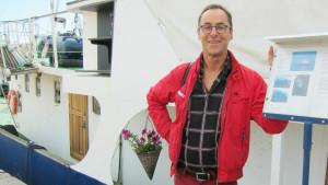 Christian Wennerstrand utanför sin husbåt