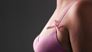 bröscancers rosa band på en rosa bh
