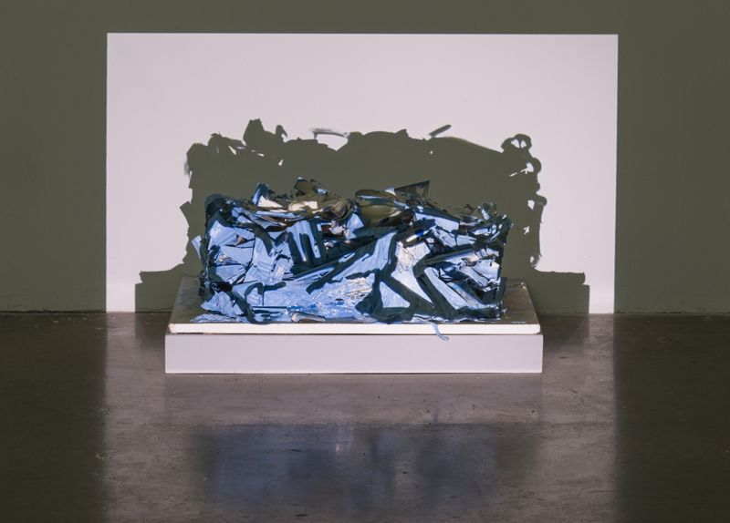 "Bessie Kunath, The Covering Up of ""Plastic Parts Block in Blue"""