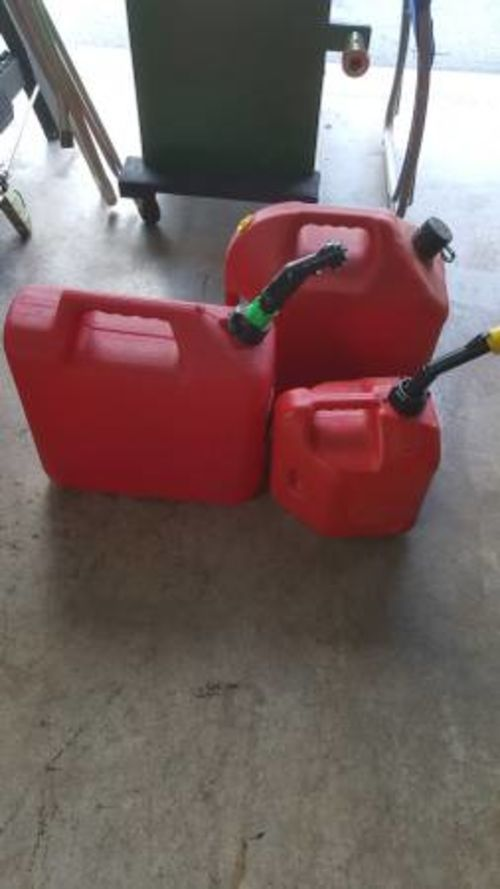 3 fuel gas cans. 2 - 5-gallon cans and 1 - 2-gallon can.