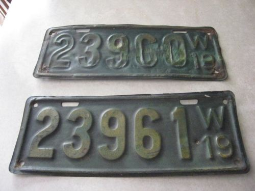 Two vintage 1919 wisconsin license plates